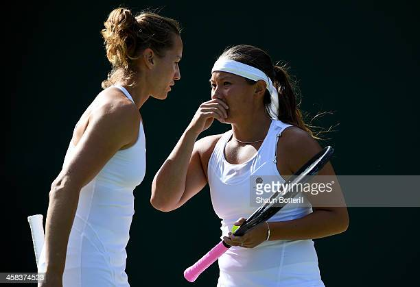 Tara Moore of Great Britain and Conny Perrin of Switzerland in conversation during the Ladies doubles first round match against Mariana DuqueMariano...