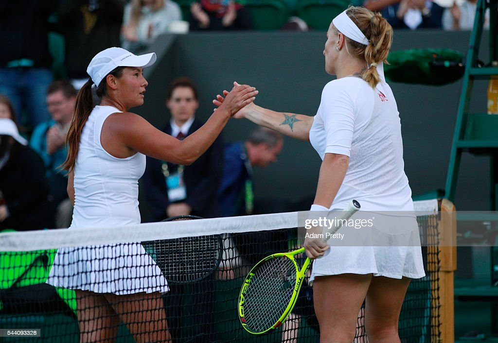 Tara moore of Great Britain and Svetlana Kuznetsova of Russia shake hands following the Ladies Singles second round match on day five of the Wimbledon Lawn Tennis Championships at the All England Lawn Tennis and Croquet Club on July 1, 2016 in London, England.