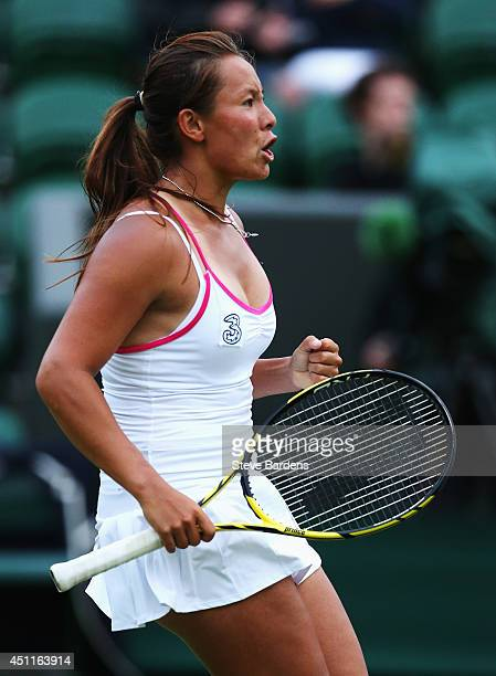 Tara Moore of Great Britain celebrates during her Ladies' Singles first round match against Vera Zvonareva of Russia on day two of the Wimbledon Lawn...