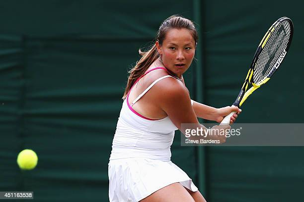 Tara Moore of Great Britain in action during her Ladies' Singles first round match against Vera Zvonareva of Russia on day two of the Wimbledon Lawn...