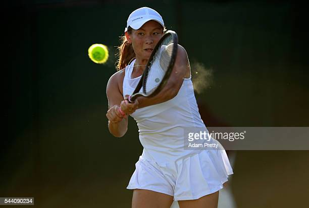 Tara moore of Great Britain plays a backhand the Ladies Singles second round match against Svetlana Kuznetsova of Russia on day five of the Wimbledon...