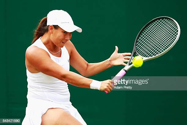 Tara moore of Great Britain plays a forehand during the Ladies Singles first round match against Alison Van Uytvanack of Belgium on day two of the...