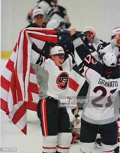 Tara Mounsey of Concord NH celebrates the US women's hockey team's Olympic victory wrapped in an American flag The US beat Canada to take the gold 31