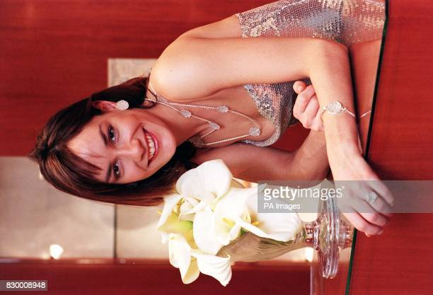 Tara Palmer Tomkinson models Lalique's new jewellery collection Fleur earrings silver/clear six flower chain silver/clear bracelet silver/clear and...
