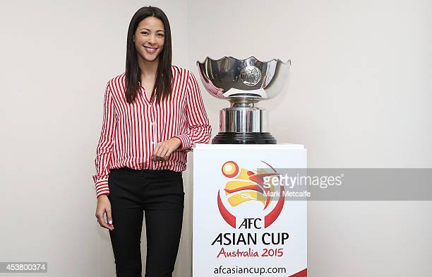 Tara Rushton poses with the Asian Cup Trophy during the AFC Asian Cup Media Ambassador Announcement at Museum of Contemporary Art on August 19 2014...