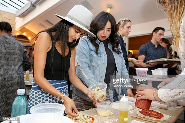 Tara Sowlaty and classmates makes pizza during Katherine Schwarzenegger's Amazon Echo cooking class at AU FUDGE on August 4 2016 in West Hollywood...