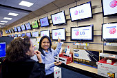 Tara Talaue helps customer Sandra Rodriguez left shop for a television inside a Best Buy store in New York US on Tuesday Dec 15 2009 Best Buy Co the...