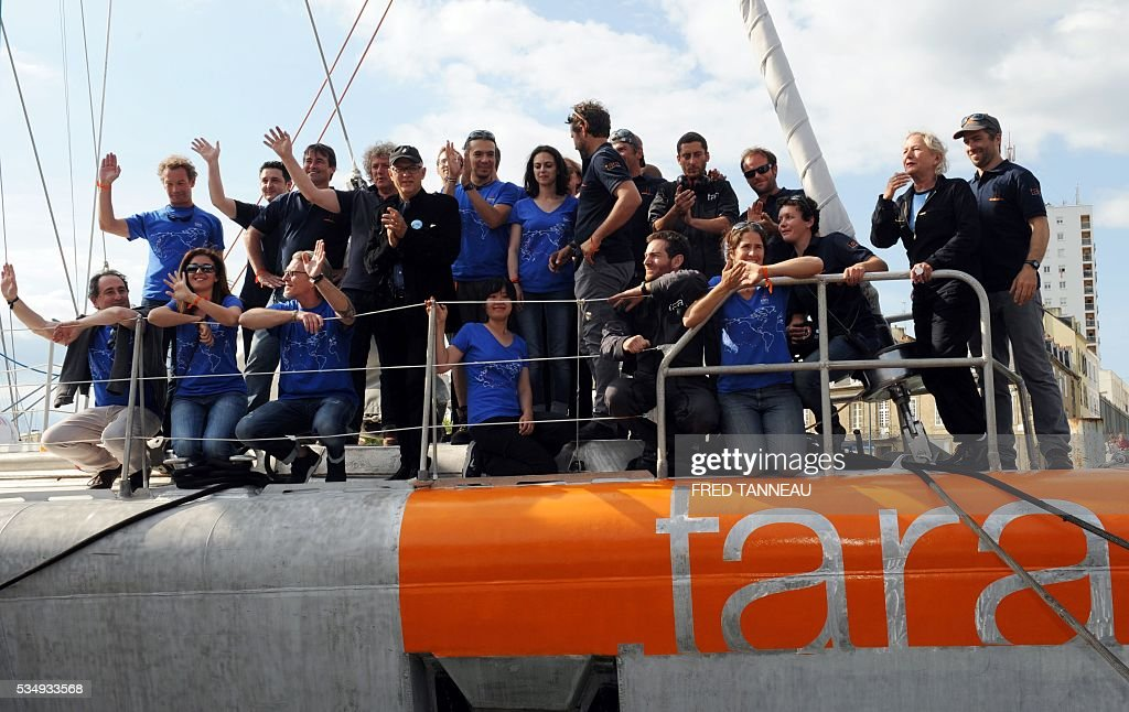 Tara team pose on the deck of the scientific boat on May 28, 2016 in Lorient, western of France, before the start of a new expedition in the Pacific Ocean. French Tara boat navigates across all the world's major oceans to sample and investigate microorganisms in the largest ecosystem on the planet. / AFP / FRED