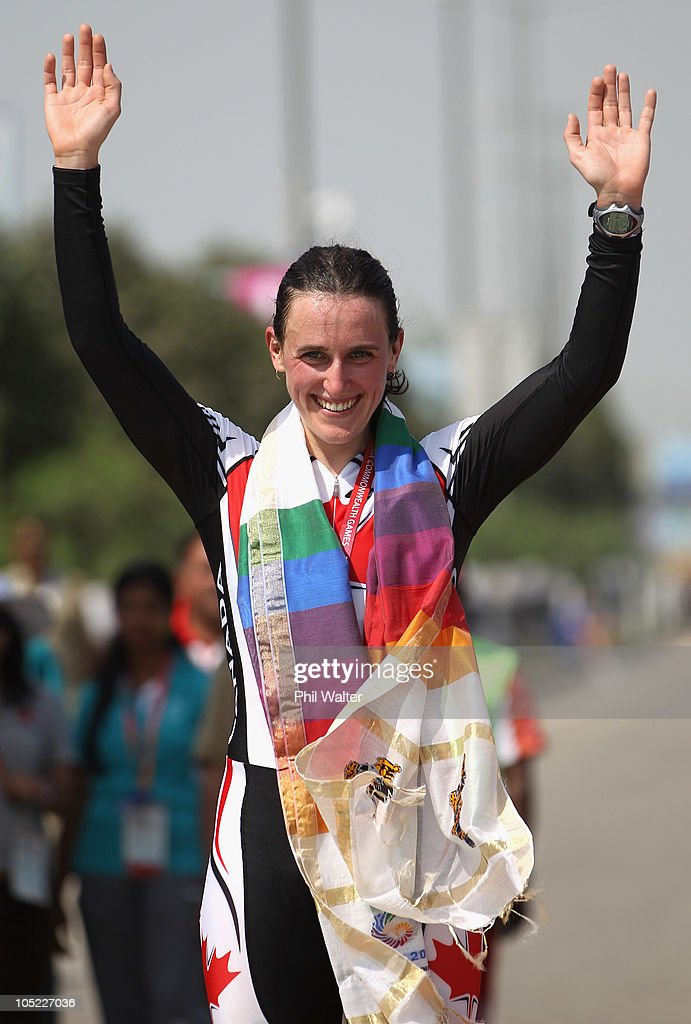 Tara Whitten of Canada celebrates her gold medal on the dias following the Womens Individual Time Trial during day ten of the Delhi 2010 Commonwealth Games on October 13, 2010 in Delhi, India.