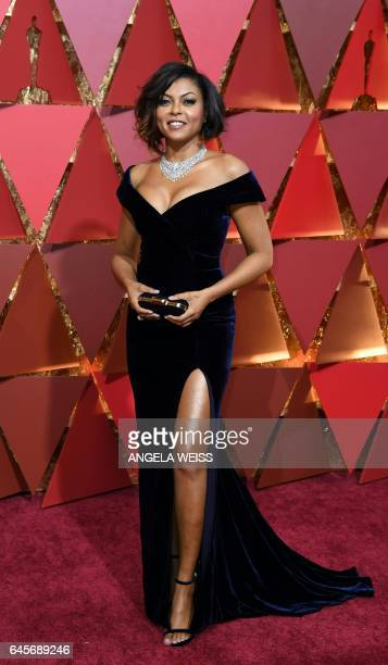 Taraji P Henson arrives on the red carpet for the 89th Oscars on February 26 2017 in Hollywood California / AFP / ANGELA WEISS
