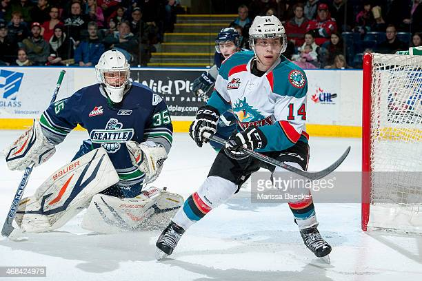 Taran Kozun of the Seattle Thunderbirds defends the net and looks for the pass to Rourke Chartier of the Kelowna Rockets during the first period on...