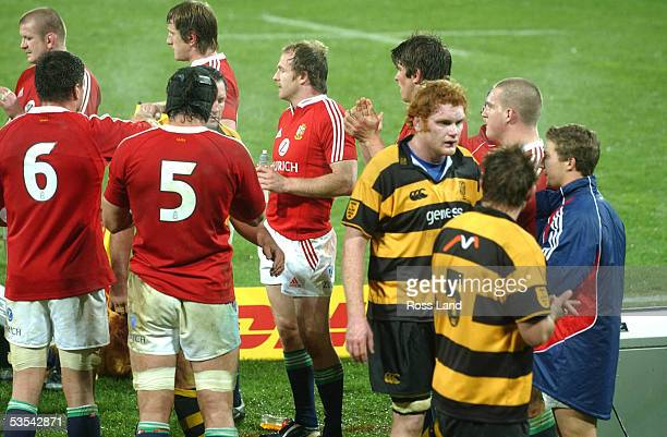 Taranaki captain Paul Tito and his team mate Scott Breman are clapped off the field by the Lions following the British and Irish Lions 3614 win over...
