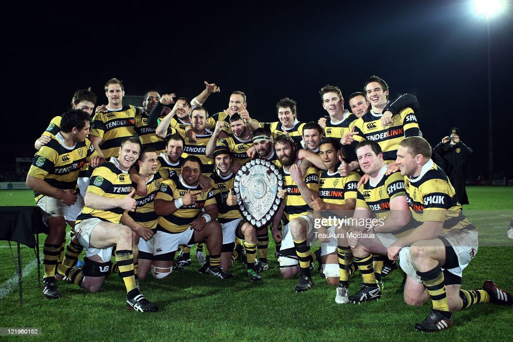 Taranaki players celebrate winning the Ranfurly Shield after the round 12 ITM Cup match between Southland and Taranaki at Rugby Park Stadium on...