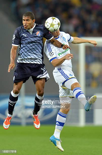 Taras Mikhalik of FC Dynamo Kiev fights for a ball with Sammir of GNK Dinamo Zagreb during UEFA Champions League Group A football match in Kiev on...