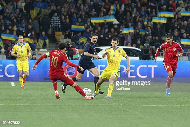 Taras Stepanenko of Ukraine national team vies with Cesc F��bregas of Spain during the during the European Qualifiers 2016 match between Ukraine and...