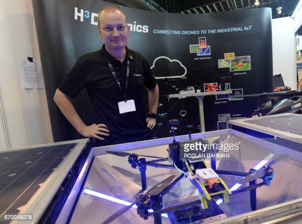 Taras Wankewycz group founder and CEO of H3Dynamics stands behind the Dronebox a cloud connected drone nesting system at Rotorcraft Asia 2017 and...