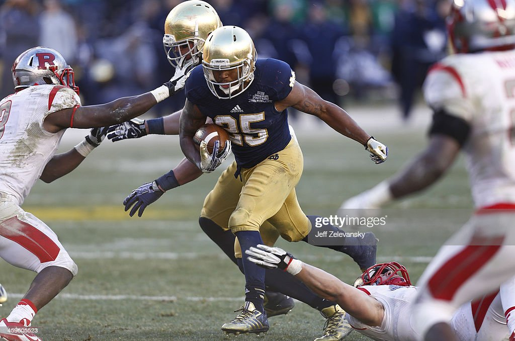 Tarean Folston #25 of the Notre Dame Fighting Irish runs during the New Era Pinstripe Bowl win over the Rutgers Scarlet Knights at Yankee Stadium on December 28, 2013 in the Bronx borough of New York City.