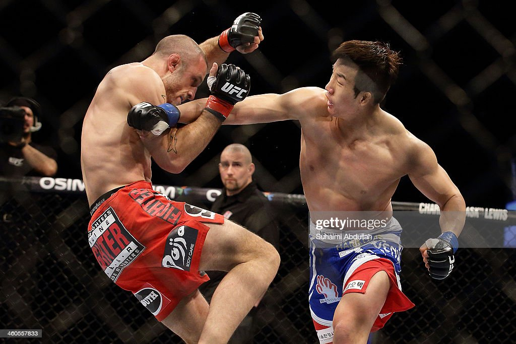 Tarec Saffiedine fights Lim Hyun Gyu during their UFC Fight Night Singapore welterweight bout at Marina Bay Sands on January 4 2014 in Singapore
