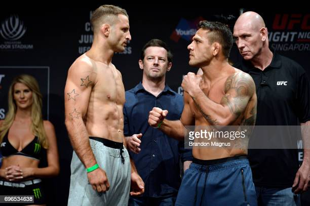 Tarec Saffiedine of Belgium and Rafael dos Anjos of Brazil face off during the UFC Fight Night weighin at the Marina Bay Sands on June 16 2017 in...