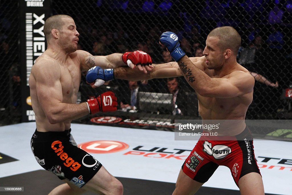 Tarec Saffiedine punches Nate Marquardt in their welterweight championship bout during the Strikeforce event on January 12, 2013 at Chesapeake Energy Arena in Oklahoma City, Oklahoma.