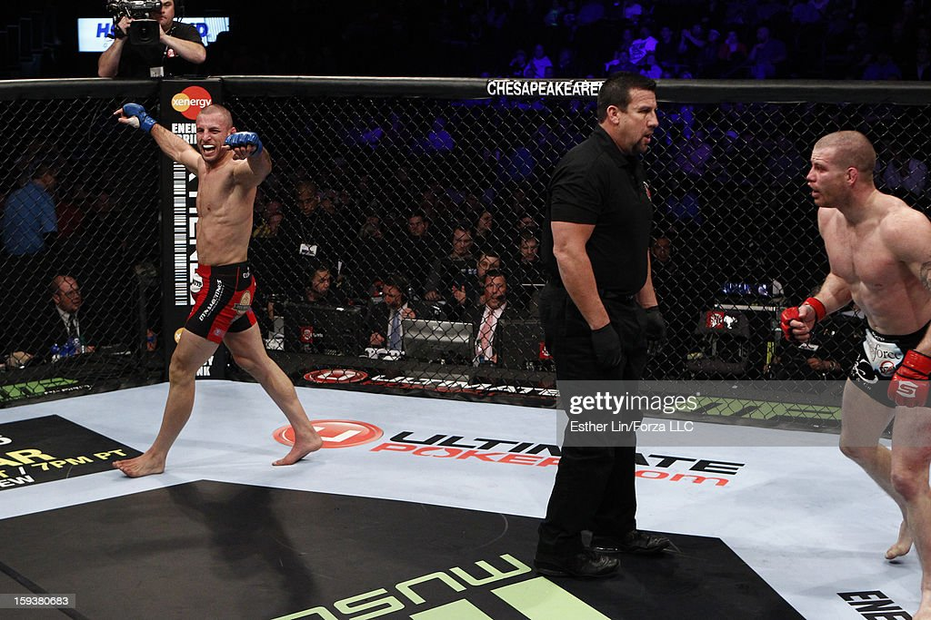 Tarec Saffiedine (L) reacts after the conclusion of his welterweight championship bout against Nate Marquardt during the Strikeforce event on January 12, 2013 at Chesapeake Energy Arena in Oklahoma City, Oklahoma.