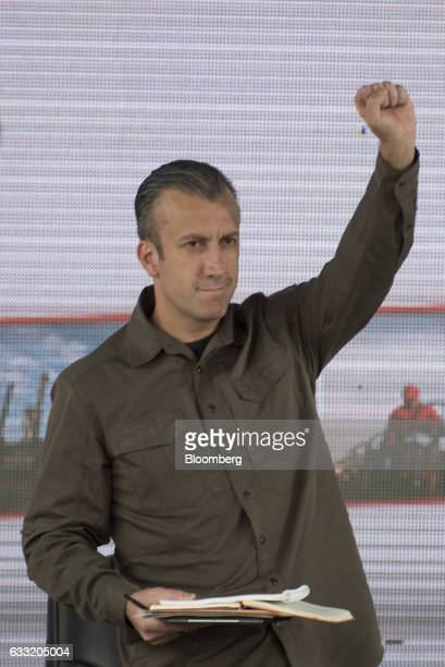 Tareck El Aissami vice president of Venezuela gestures to the audience during a swearing in ceremony for the new board of directors of Petroleos de...