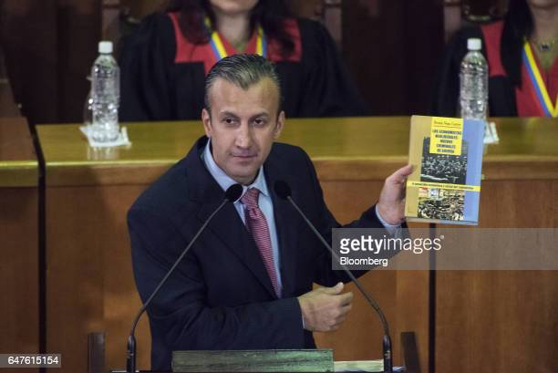 Tareck El Aissami vice president of Venezuela holds up the book 'The Neoliberal Economics New War Criminals' by Renan Vega Cantor during the annual...