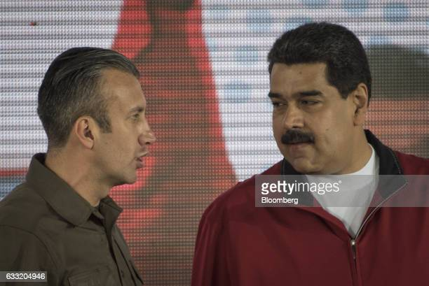 Tareck El Aissami vice president of Venezuela left speaks with Nicolas Maduro president of Venezuela during a swearing in ceremony for the new board...