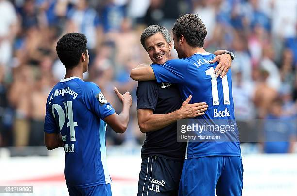 Tarek Chahed head coach Jens Haertel and Christian Beck of Magdeburg celebrate after the Third League match between 1 FC Magdeburg and Hallescher FC...