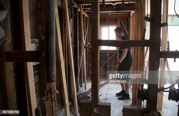 Tarek El Moussa removes termite damaged wood during the filming of an episode of 'Flip or Flop' on July 2 2014 on a house in Anaheim California