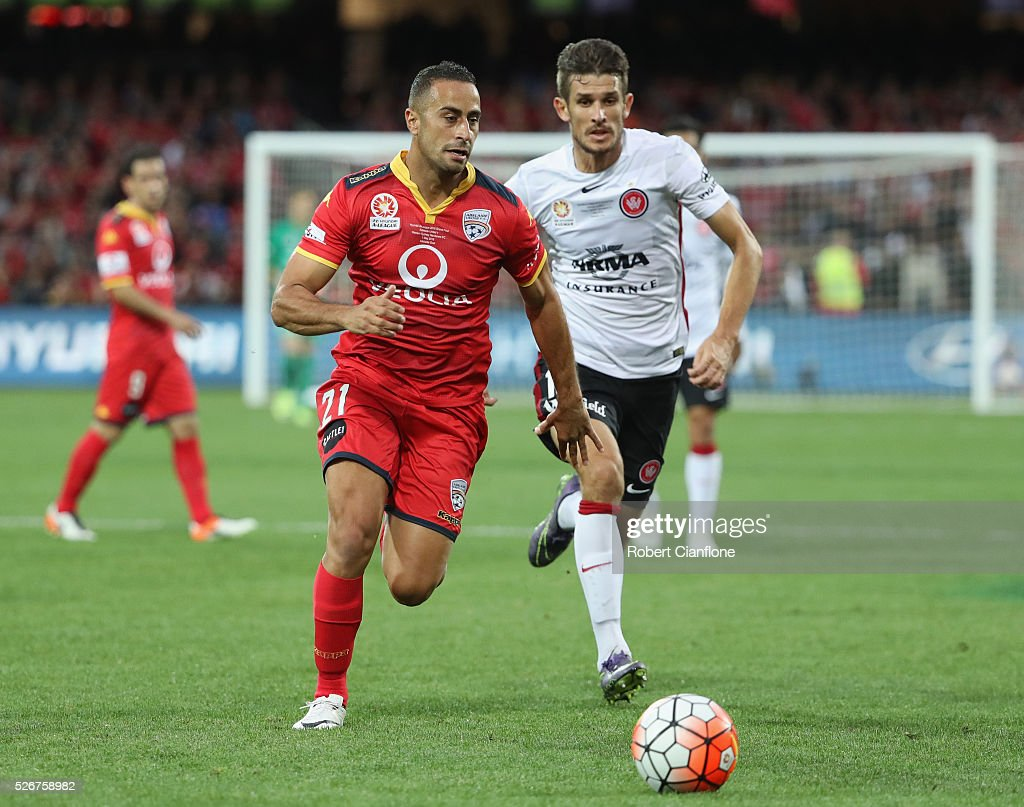 Tarek Elrich of Adelaide United is chased by Dario Vidosic of the Wanderers during the 2015/16 A-League Grand Final match between Adelaide United and the Western Sydney Wanderers at Adelaide Oval on May 1, 2016 in Adelaide, Australia.