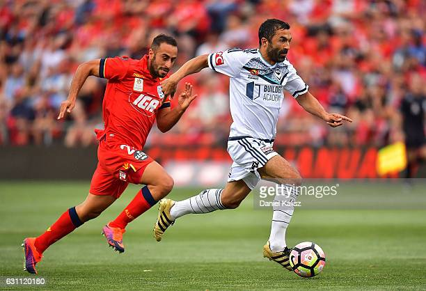 Tarek Elrich of United attempts to tackle Fahid Ben Khalfallah of the Victory during the round 14 ALeague match between Adelaide United and Melbourne...