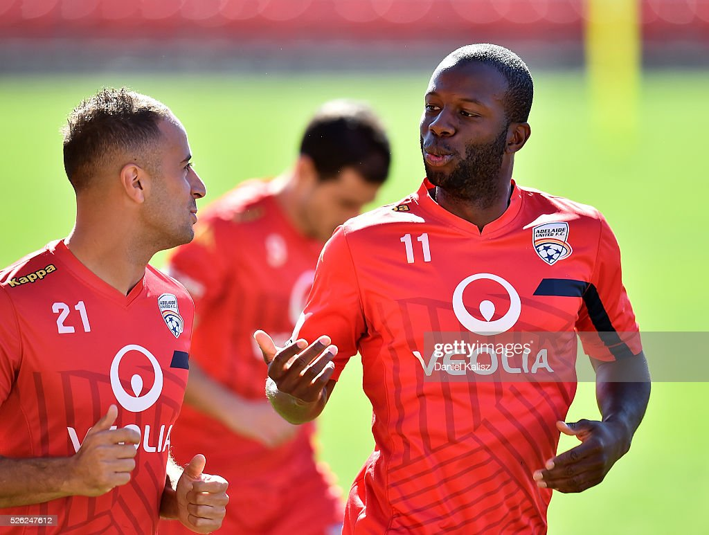 Tarek Elrich of United chats with Bruce Djite of United during an Adelaide United A-League training session at Coopers Stadium on April 30, 2016 in Adelaide, Australia.