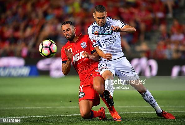 Tarek Elrich of United competes for the ball with Jai Ingham of the Victory during the round 14 ALeague match between Adelaide United and Melbourne...