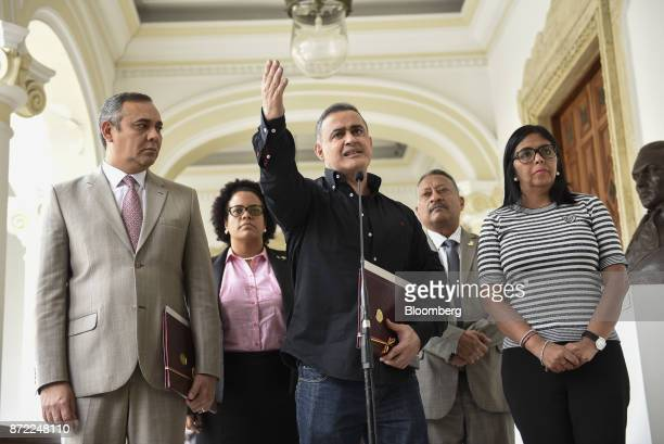 TarekWilliam Saab Venezuela's chief prosecutor center speaks while Maikel Moreno president of the Supreme Court of Venezuela from left and Delcy...