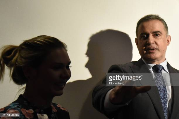 TarekWilliam Saab Venezuela's chief prosecutor right exits following a press conference in Caracas Venezuela on Monday Aug 7 2017 The assembly...