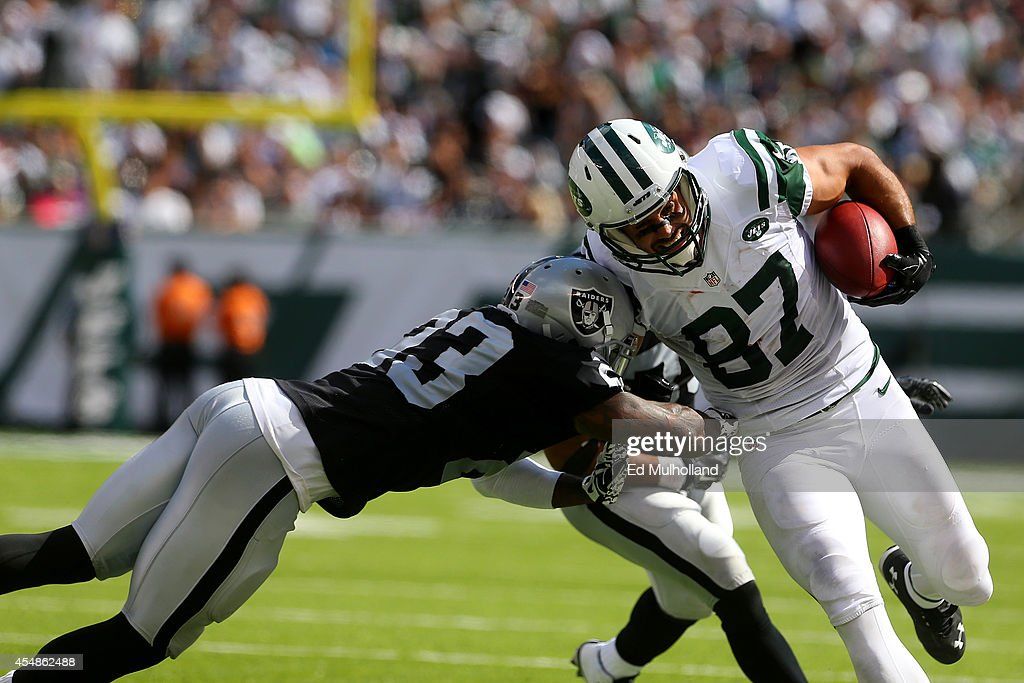 <a gi-track='captionPersonalityLinkClicked' href=/galleries/search?phrase=Tarell+Brown&family=editorial&specificpeople=2105844 ng-click='$event.stopPropagation()'>Tarell Brown</a> #23 of the Oakland Raiders tackles <a gi-track='captionPersonalityLinkClicked' href=/galleries/search?phrase=Eric+Decker&family=editorial&specificpeople=3950667 ng-click='$event.stopPropagation()'>Eric Decker</a> #87 of the New York Jets after a catch and run during the third quarter at MetLife Stadium on September 7, 2014 in East Rutherford, New Jersey.