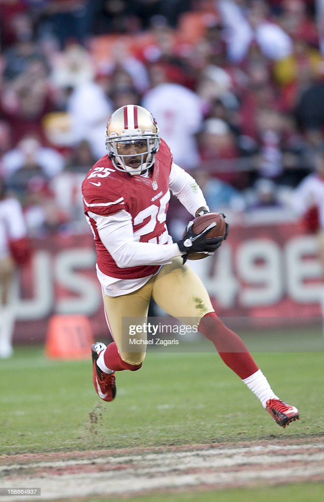 Tarell Brown #25 of the San Francisco 49ers intercepts a pass and takes it down field during the game against the Arizona Cardinals at Candlestick Park on December 30, 2012 in San Francisco, California. The 49ers defeated the Cardinals 27-13.