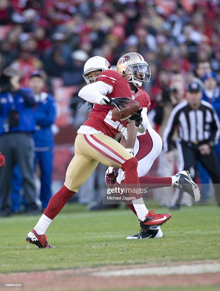 Tarell Brown #25 of the San Francisco 49ers intercepts a pass during the game against the Arizona Cardinals at Candlestick Park on December 30, 2012 in San Francisco, California. The 49ers defeated the Cardinals 27-13.