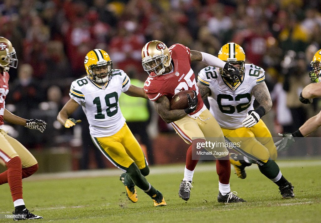 Tarell Brown #25 of the San Francisco 49ers returns an interception during the game against the Green Bay Packers at Candlestick Park on January 12, 2012 in San Francisco, California. The 49ers defeated the Packers 45-31.