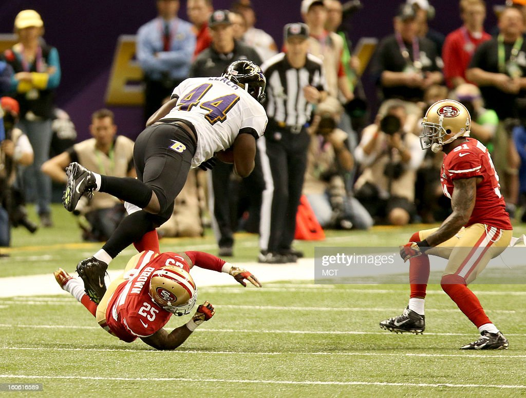 Tarell Brown (25) of the San Francisco 49ers upends Vonta Leach (44) of the Baltimore Ravens during second-quarter action in Super Bowl XLVII at the Mercedes-Benz Superdome in New Orleans, Louisiana, Sunday, February 3, 2013.