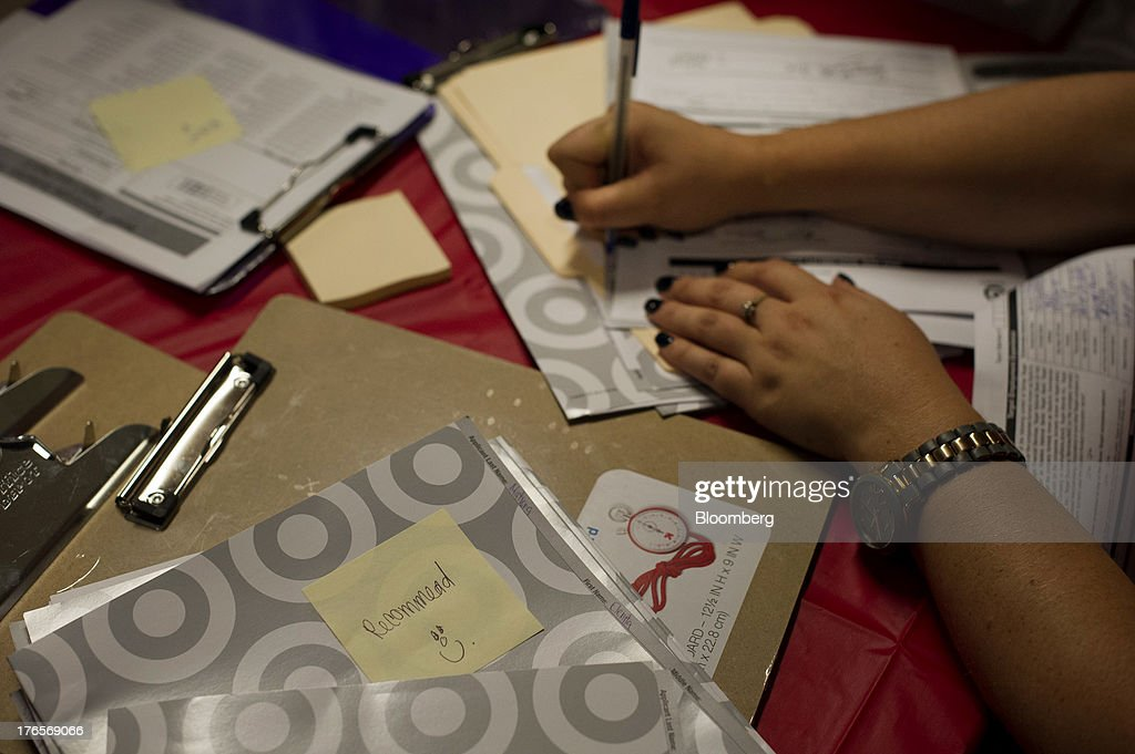 A Target Corp. employee makes notes during a hiring event at a new store in San Francisco, California, U.S., on Thursday, Aug. 15, 2013. Claims for jobless benefits unexpectedly dropped by 15,000 to 320,000 in the week ended Aug. 10, the fewest since October 2007. Photographer: David Paul Morris/Bloomberg via Getty Images