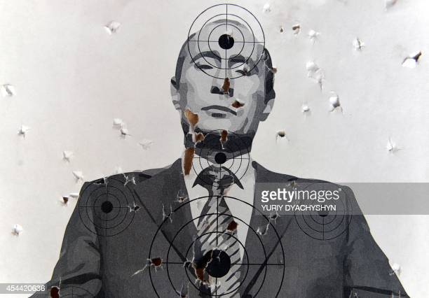 A target depicting a portrait of Russian President Vladimir Putin in a shooting range in the center of the western Ukrainian city of Lviv on August...
