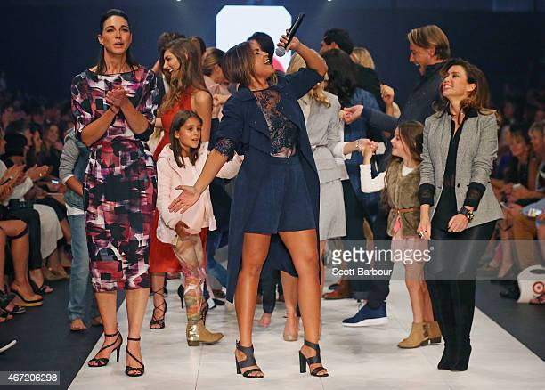 Target designers Dannii Minogue and Giaan Rooney dance with Australian singer Jessica Mauboy on the runway at the Target show during Melbourne...