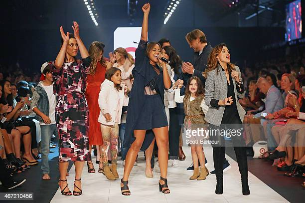 Target designers Dannii Minogue and GiaanRooney dance with Australian singer Jessica Mauboy on the runway at the Target show during Melbourne Fashion...
