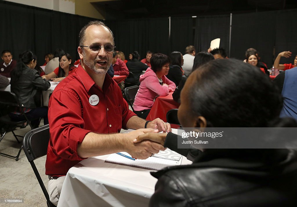 A Target employee greets a job seeker at the start of an interview during a job fair at a new Target retail store on August 15, 2013 in San Francisco, California. Hundreds of job seekers applied for jobs during a job fair to staff a new Target City store. According to a report by the Labor Department, the number of people seeking first time unemployment benefits fell to the lowest level since 2007 with initial jobless claims decreasing by 15,000 to 320,000.