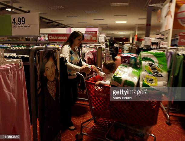 Target shopper Amy Mustafa with her son Omar 15monthsold shops for paper goods and diapers during the early part of the massive power outage in...