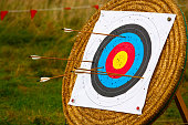Target stand for archery with arrows in it and holes from previous hits