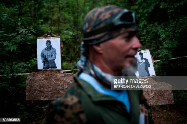 Targets are seen before members of the Georgia Security Force III% militia participate in live fire training during a field training exercise July 29...