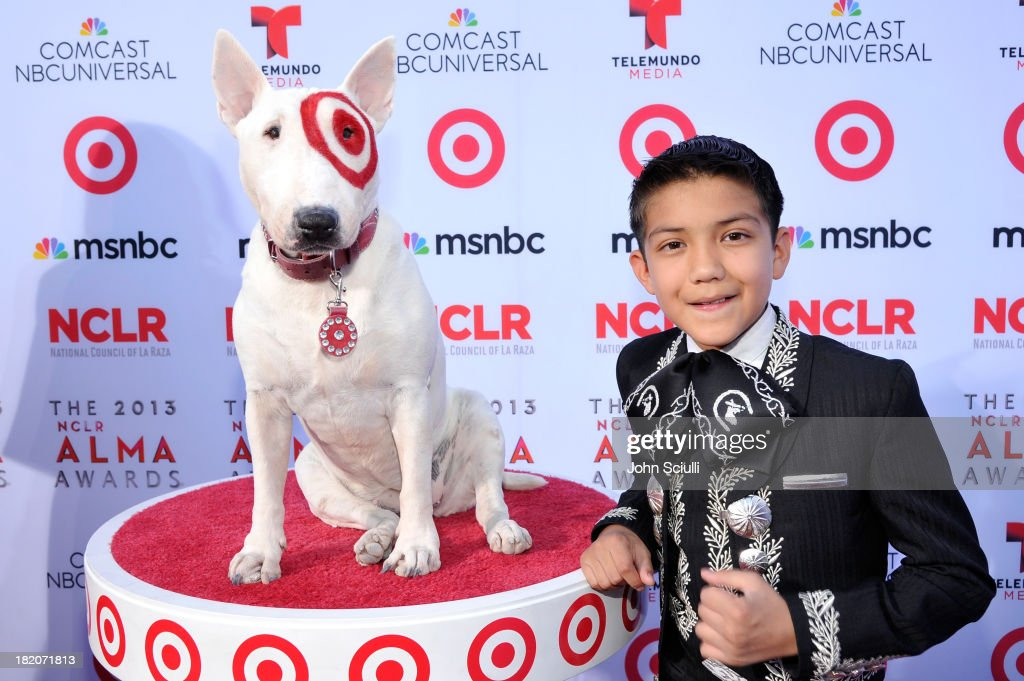 Target's bull terrier mascot Bullseye and singer Sebastien De La Cruz celebrate the 2013 NCLR ALMA Awards sponsored by Target at Pasadena Civic Auditorium on September 27, 2013 in Pasadena, California.